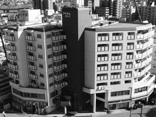 管理組合「修繕奮闘記」/街道沿いの複合用途マンション